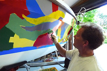 Artist Bill Barnhart adds finishing touches tothe crazy topsides.